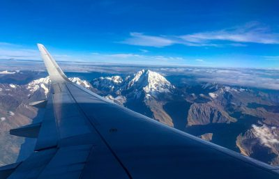 Airplane flying over Andes mountains in Peru